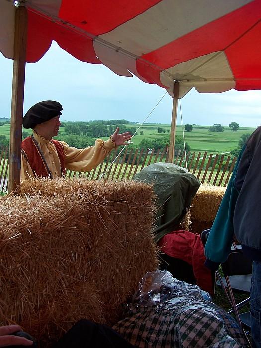 man behind hay bales
