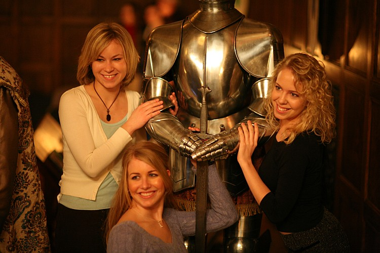 Girls posing with knight armor