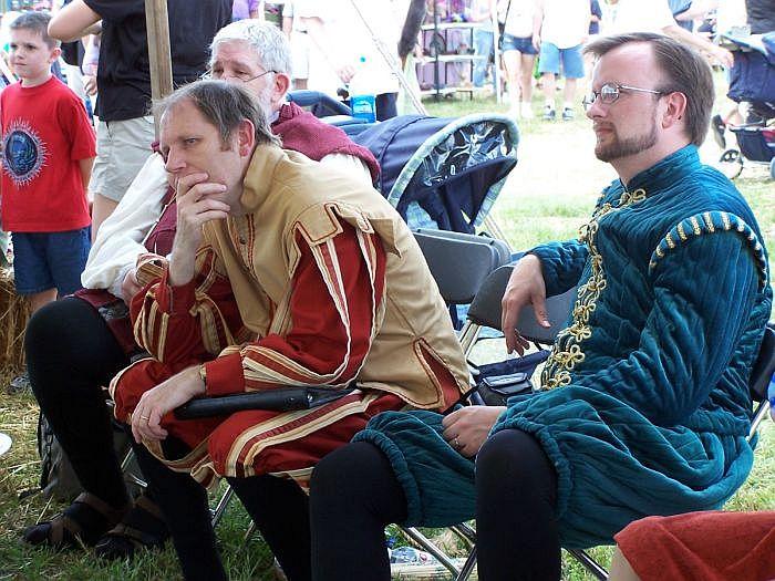 Music men watching performers