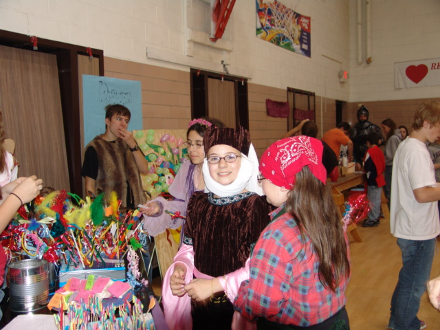 Student=ts at a fair booth smiling