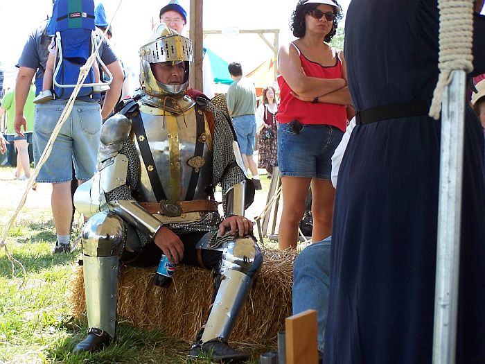 Faire goer dressed as knight