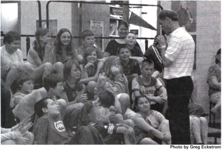 Alan showing students a soprano recorder