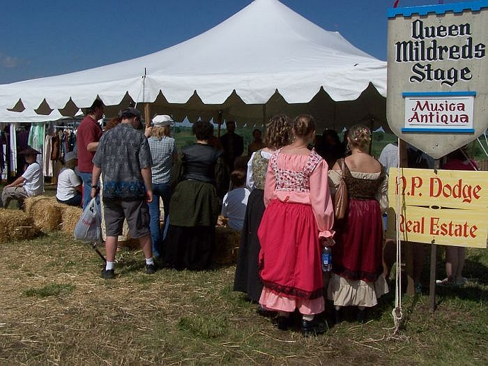 Faire goers gather around the musica antiqua tent