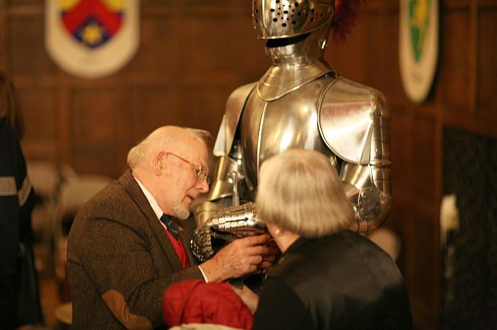 Audience members examine armor
