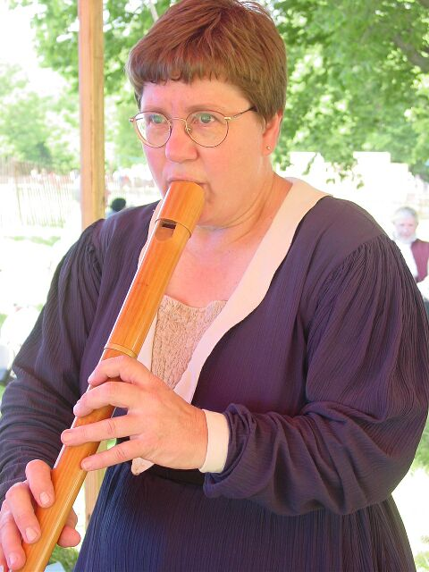 Dee playing the recorder