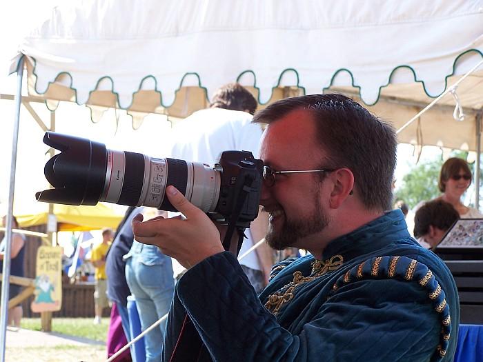 Music Man taking photos