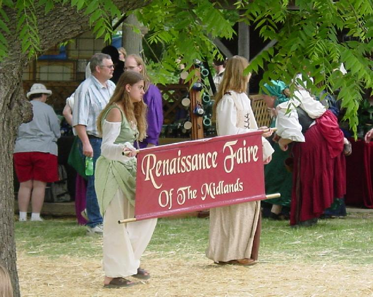 faire sign held by two maidens