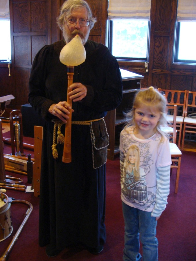 Doc with a bladder pipe and young audience member