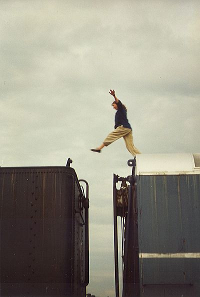 Performer jumping from one train car to another
