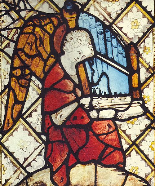 organetto being played depicted in stained glass