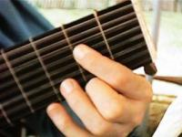 close up on fingers playing lute