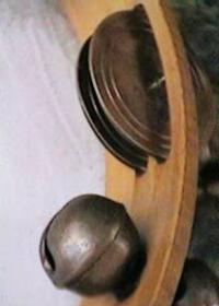 closeup of tambourine metal discs and bells
