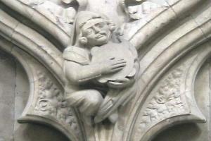 statue playing tambourine