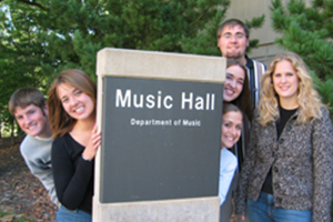 Students with Music Hall sign