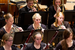 students playing instruments in concert band