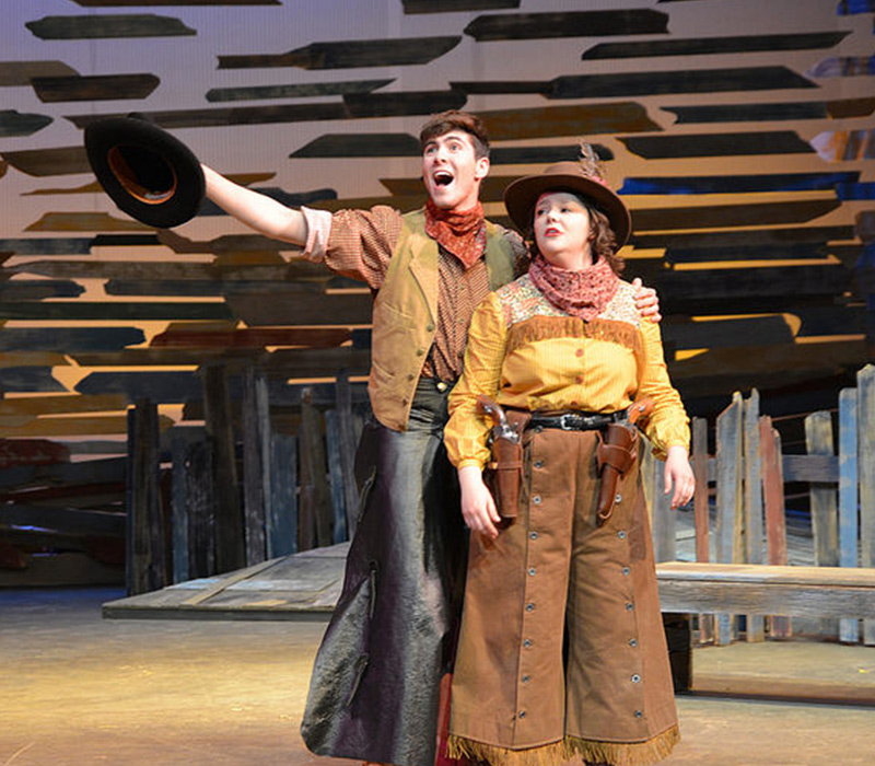 two actors on stage in Oklahoma!