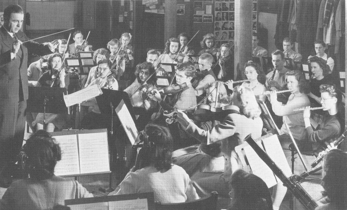 Alvin Edgar conducts the ISC orchestra in 1944.