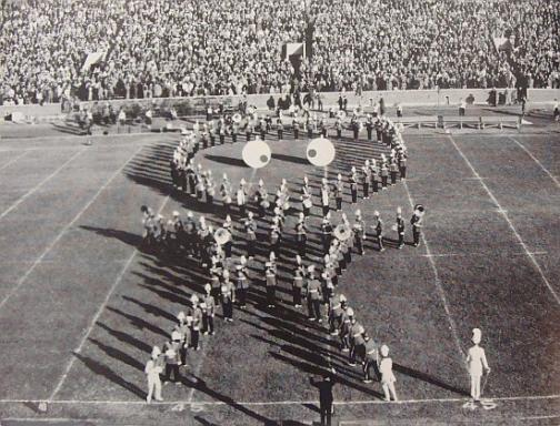"""The band creating a """"Man from Mars"""" Figure on the field."""