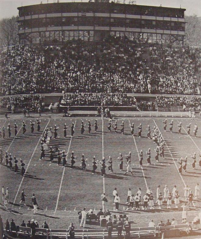 The marching band creating a formation during half-time show