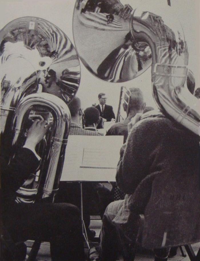 Two tubas playing