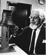 Percival Price looking at a bell