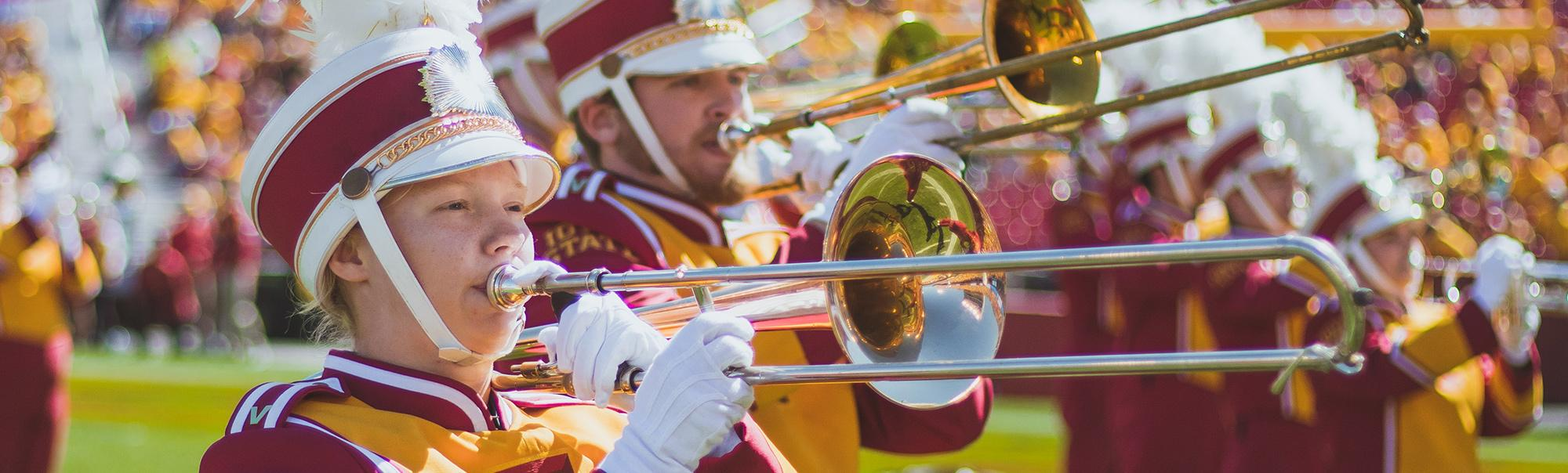 closeup photo of marching band trombone players.